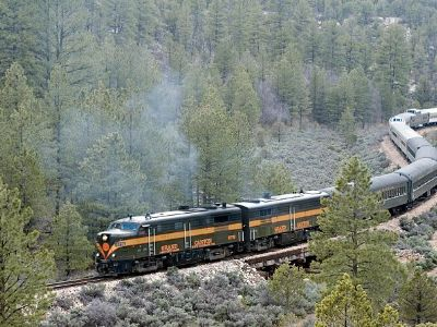 A train is departing the Grand Canyon back to Arizona