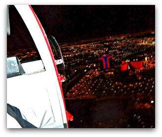 night view of Las Vegas Strip from helicopter with doors off